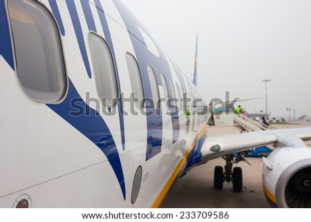 BOLGNA, ITALY - November 23, 2014: A Ryanair aircraft getting ready for departure from the Bologna BLQ Airport. Ryanair is the biggest low-cost airline company in the world.