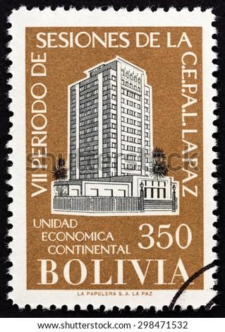 """BOLIVIA - CIRCA 1957: A stamp printed in Bolivia from the """"The 7th Latin America Economic Congress, La Paz """" issue shows Congress Buildings Santiago de Chile and La Paz, circa 1957. - stock photo"""