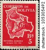 BOLIVIA - CIRCA 1954: A stamp printed in Bolivia honoring 1st Anniversary of Agrarian Reform, shows cow on background of Bolivian map - stock photo