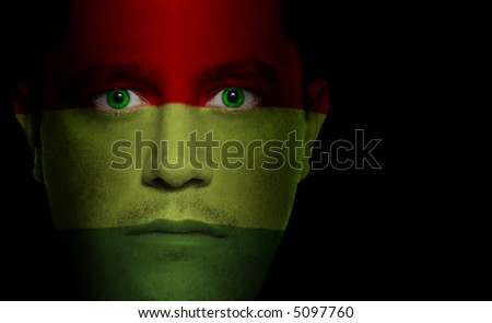 Bolivian flag painted/projected onto a man's face.