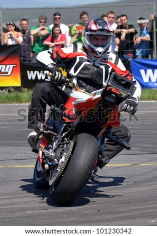 BOLKOVCE, SLOVAKIA - APRIL 28: Angyal Zolt�¡n from Stunt show - Hungary performs stunt using motorcycle during the MAD POWER FEST, on April 28, 2012 in Bolkovce, Slovakia