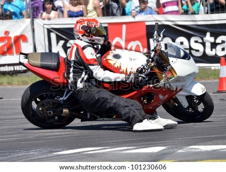 BOLKOVCE, SLOVAKIA - APRIL 28: Angyal Zolt�¡n from Stunt show - Hungary performs stunt using motorcycle during the MAD POWER FEST, on April 28, 2012 in Bolkovce, Slovakia - stock photo