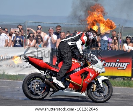 BOLKOVCE, SLOVAKIA - APRIL 28: Angyal Zoltan from Stunt show - Hungary performs stunt using motorcycle during the MAD POWER FEST, on April 28, 2012 in Bolkovce, Slovakia - stock photo