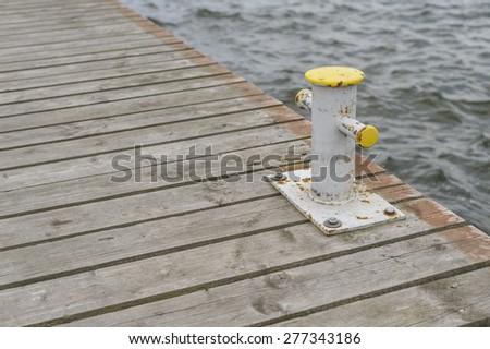Bollard on jetty - stock photo