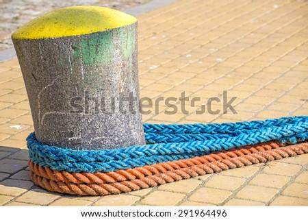Bollard with mooring lines   - stock photo