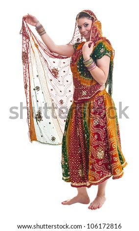 Bollywood dancer in traditional beautiful orange dress with veil - stock photo