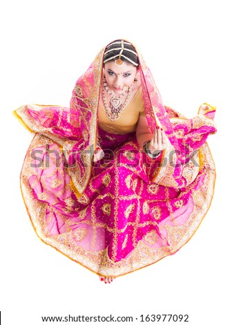 Bollywood dancer in traditional beautiful pink wedding dress - stock photo