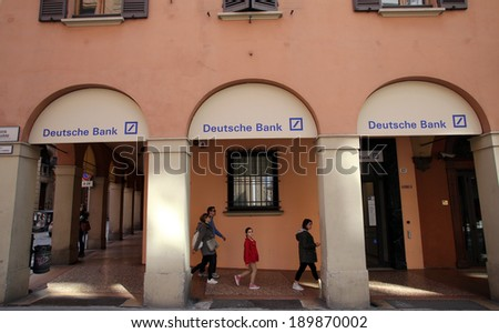 BOLOGNA, ITALY - APRIL 19, 2014: A group of pedestrians walk past a branch office of Deutsche Bank in Bologna, Italy, on Saturday, April 19, 2014.  - stock photo