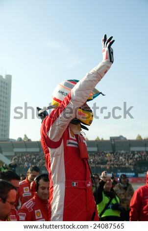 BOLOGNA,ITALY-06 DECEMBER: Luca badoer, ferraris test driver, says hello to the crowd after his performance at the 2008 edition of Motor Show in Bologna,Italy