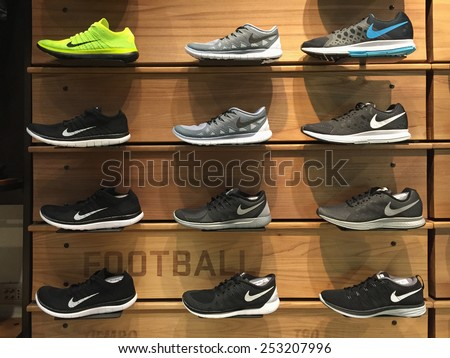 BOLOGNA, ITALY - FEBRUARY 16 2014: Exposition of nike sport shoes. Nike is one of the world's largest suppliers of athletic shoes and apparel. The company was founded on January 25, 1964. - stock photo
