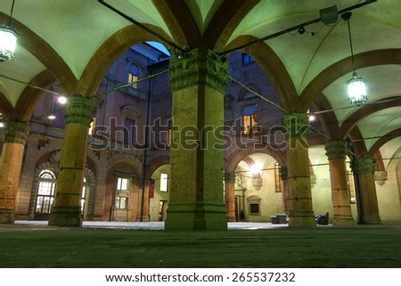 BOLOGNA, ITALY - FEBRUARY 6, 2015: The inner courtyard of the Archiginnasio palace at night - stock photo
