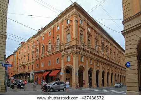 BOLOGNA, ITALY â?? JULY 29, 2014: locals and tourists walking in a downtown street. This is a medieval part of the city. - stock photo