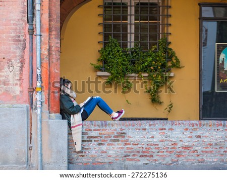 BOLOGNA, ITALY - MARCH 11, 2015: College student preparing for examination - stock photo