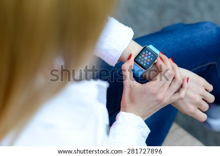 BOLOGNA, ITALY - MAY 17, 2015: One girl wears the apple watch - stock photo
