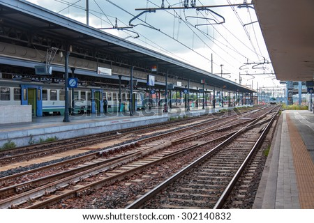 BOLOGNA, ITALY, on MAY 2, 2015. Passengers expect arrival of the train on the platform of the Central station - stock photo