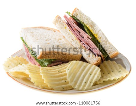 Bologna sandwich with potato chips, isolated on a white background. - stock photo