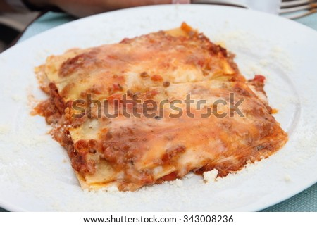 Bolognese lasagne on plate Italy