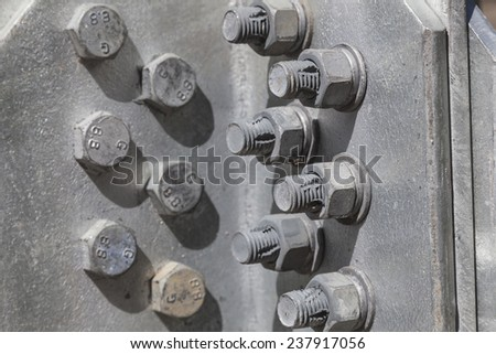 bolts and nuts in the structure of a steel tower horizontal - stock photo