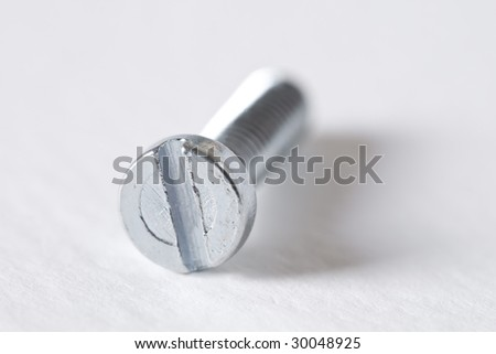 bolts and nuts with shallow depth of field - stock photo