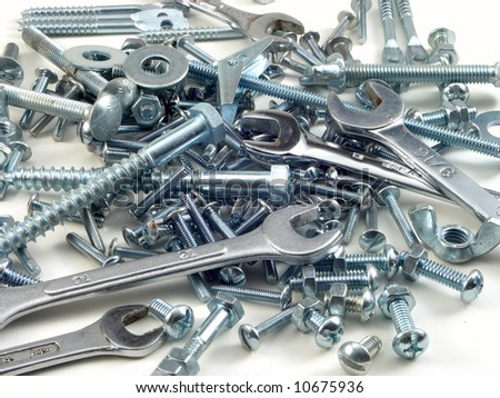 bolts and nuts with wrenches