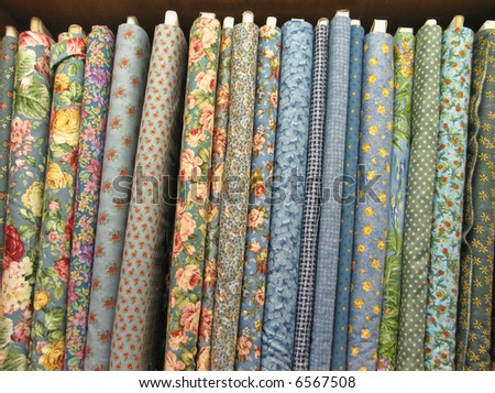 Bolts of colorful fabric - stock photo