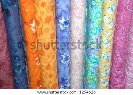 Bolts of quilting fabric. - stock photo