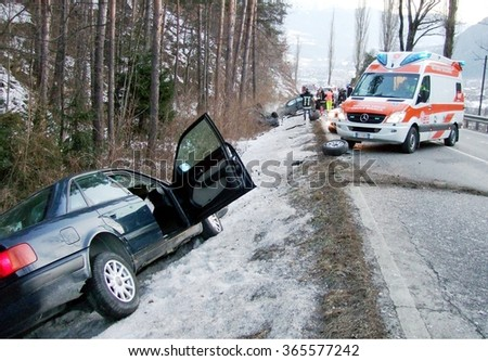 BOLZANO BOZEN, ITALY - JANUARY 18, 2016: Ambulance rescue comes in the scene of an accident caused by the high speed and the road made treacherous by ice and snow on  Bolzano Bozen, Italy. - stock photo