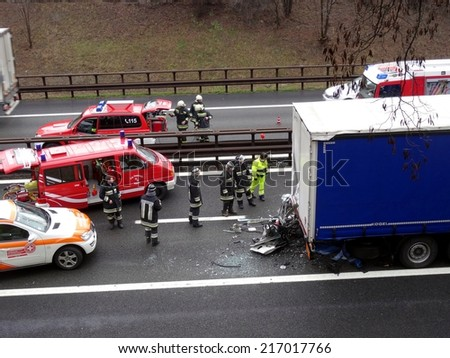 BOLZANO, ITALY - APRIL 16, 2014: Hard collision between cross-country vehicle and truck. Accident with injured motorist and intervention of police and paramedics on highway on Bolzano, April 16, 2014 - stock photo