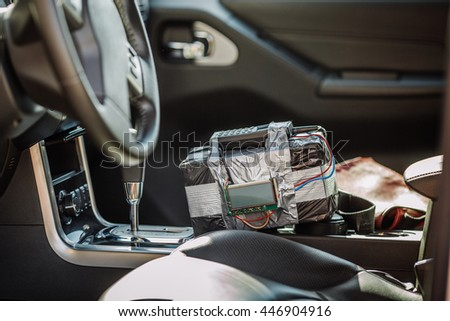 bomb with radio control and digital countdown timer lies in the car. terrorism and dangerous life concept - stock photo