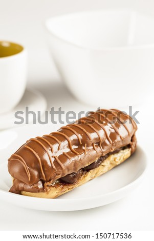 Bomba de chocolate. A Brazilian traditional eclair on a white background. - stock photo