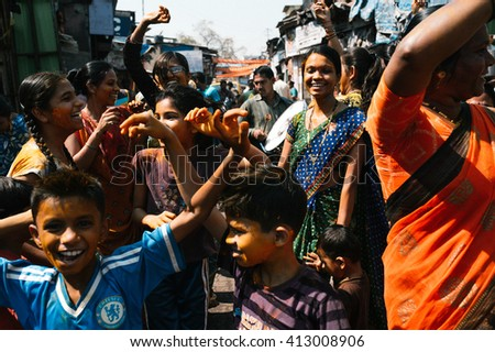 Bombay, India - March 12 2015: Indian crowd dancing in the street during Holi festival - Mar, 12, 2015 at Bombay, India