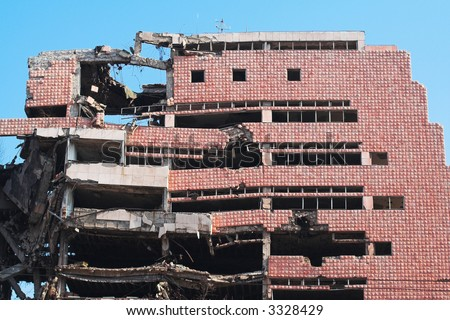 Bombed and abandoned city building. Architecture ruins and destruction - stock photo