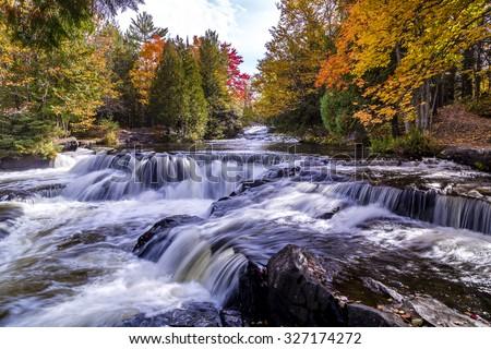 Bond Falls , Beautiful Autumn leaves, Middle branch Ontonagon river, Paulding Michigan, USA - stock photo