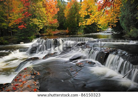 Bond Falls , Beautiful Autumn leaves, Middle branch Ontonagon river, Paulding Michigan, USA - stock photo