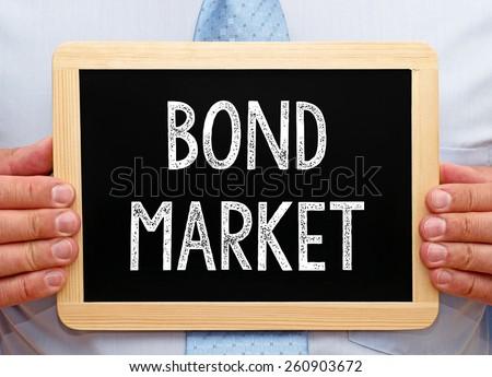 Bond Market - Businessman with chalkboard - stock photo