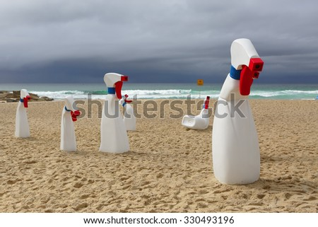BONDI, AUSTRALIA - OCTOBER 22, 2015;  Annual Sculpture by the Sea public event.  Exhibit titled  The Bottles by RCM Collective.  Human sized spray and wipe cleaning bottles - stock photo