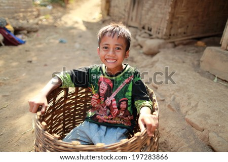 Bondowoso, INDONESIA - September 15: Unidentified poor kid plays in basket at school on September 15, 2012. Bondowoso involves cultures from different nations.There is a big Arabic there for long time - stock photo