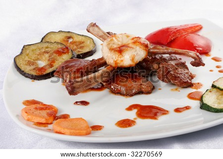 Bone lamb platter. Teppan yaki dish - stock photo