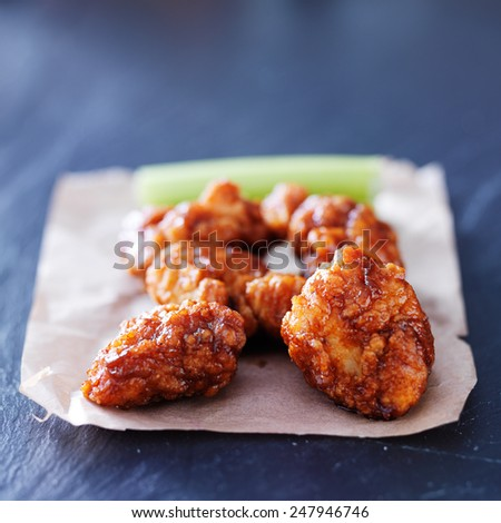 boneless barbecue chicken wings on slate table - stock photo