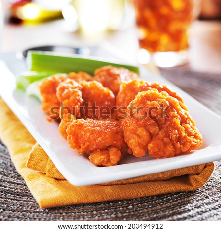 boneless buffalo chicken wings with celery and ranch - stock photo