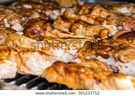 Boneless ribs cooking on a outdoor grill - stock photo