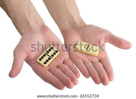 Bones of dominoes on male hands on the white