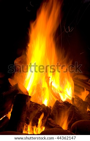 Bonfire blazing flame with spiral sparks - stock photo