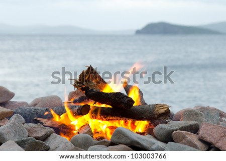 Bonfire in the background of the sea - stock photo