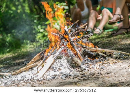 Bonfire in the forest. Happy holidays. - stock photo