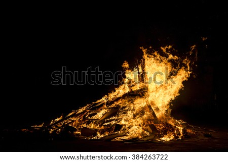 Bonfire night for the celebration of Sant Joan on a street in Barcelona, Catalonia, Spain - stock photo
