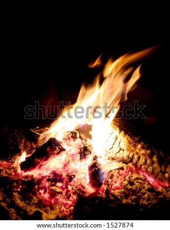 Bonfire Warms Campsite - stock photo