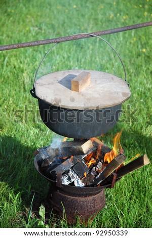 bonfire with pot - stock photo
