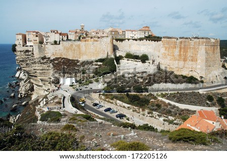 Bonifacio castle on a cliff in the Corsican shoreline  - stock photo