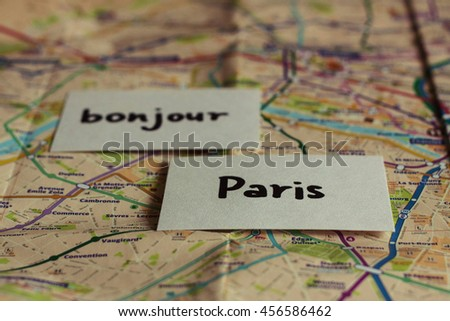 Bonjour Paris French flash cards on the map of Paris - stock photo